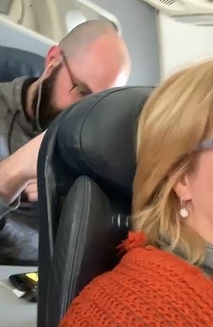 American Airlines passenger shames traveller who repeatedly punched her seat when she reclined it