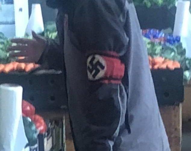 Man proudly wearing a Nazi swastika armband shocks shoppers as he strolls into a supermarket
